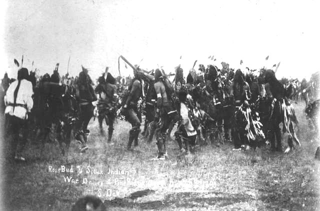 Rosebud and Sioux Indian, War Dance at Pine Ridge 1890 : Native American Lakota Sioux men and boys perform a dance on the Pine Ridge Agency, South Dakota.